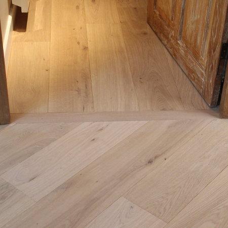 Changement de sens de pose des lames du plancher parquet en bois.